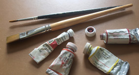 Selection of watercolour paints and brushes.